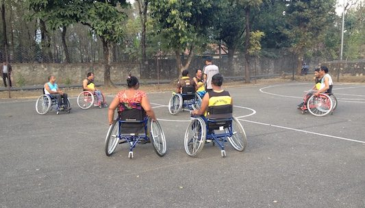 ILS members play wheelchair basketball to help keep fit and to have some fun.